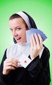 stock photo of nun  - Nun in the gambling concept - JPG