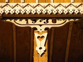 stock photo of carving  - Detail of a beautiful wooden carving on the old cottage - JPG