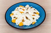 image of curd  - Grainy curd with peaches raisins and sour cream in blue plate on wooden table - JPG