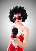 picture of pop star  - Pop star with mic in red dress against gradient  - JPG