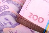 stock photo of payday  - Pile of Ukrainian money - JPG