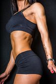 stock photo of abdominal muscle  - A female fitness model showing her abdominal muscles - JPG