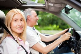 stock photo of maturity  - Mature couple traveling in their car - JPG