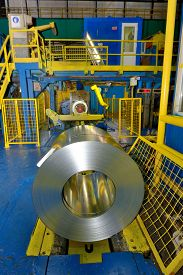 stock photo of coil  - Coiled steel sheets inside of steel plant - JPG