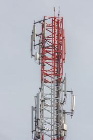 stock photo of lightning-rod  - Close up white color antenna repeater tower on blue sky - JPG