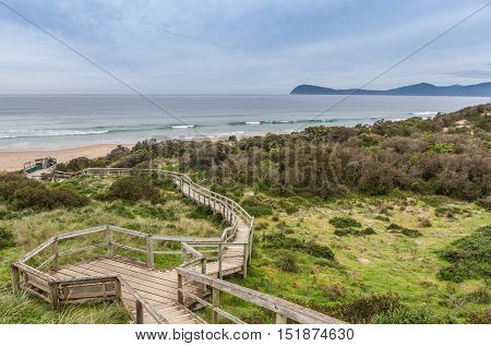 Boardwalk To The Beach At