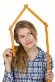 stock photo of meter stick  - young woman forms meter stick into a house shape - JPG