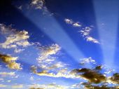 stock photo of sun rays  - Photograph of sun rays coming through the clouds - JPG