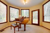 Round Piano Room With Many Bright Windows