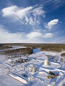 picture of oil drilling rig  - Construction site in wild winter forest - JPG