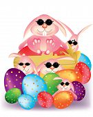 Colorful Easter eggs with ribbon and smart bunny rabbit