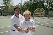 Active Senior With Tennis Pro