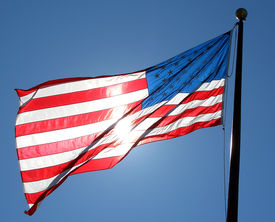 stock photo of waving american flag  - american flag glowing in the sunshine - JPG