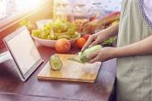 Female Hand Slicing Green Vegetable, Prepare Ingredients For Cooking Follow Cooking Online Video Cli poster