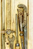 Different Types Of Tools, Assorted Tools Aranged On A Wooden Bench In Yellow Color Rusty Old Tools,  poster
