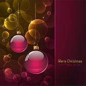 colorful cristmas card with baubles and warm blurred lights