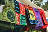 Bohemian Bags Made From Natural Materials At A Clothes Stand In A Hippy Festival Market poster