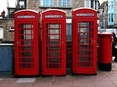 Three Phoneboxes And A Postbox poster