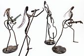 Figures Of Music Performers Made With Welded Black Metal Wire. Band Made Of: Guitarist, Contrabass A poster