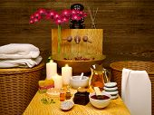 Composition Of Spa Treatment With Orchid On Wooden Background. Spa And Wellness Setting With Natural poster
