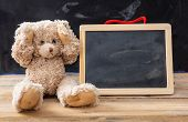 Teddy Bear Covering Ears And A Blank Blackboard, Space For Text poster