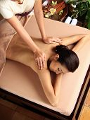 Woman in a day spa getting a deep tissue massage.