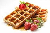 waffle breakfast with strawberry and honey maple syrup