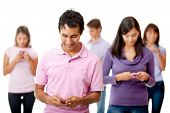 People texting on their cell phones social networking - isolated