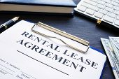 Rental Lease Agreement With Pen On A Desk. poster