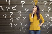 Question Marks With Young Woman In A Thoughtful Pose poster