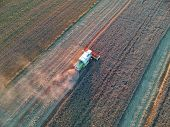 Combine Harvester Collecting Grain On Wheat Field, Aerial View Of Harvest. poster