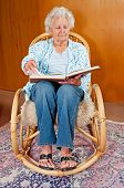image of broad-bodied  - Portrait of a senior woman in rocking chair - JPG