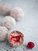 Raw Vegan Lamington Bliss Balls With Raspberries Chia Jam On Gray Background. No Baked Healthy Vegan poster