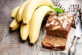 Homemade  Banana Loaf Cake With Fresh Bananas On Wooden Table poster