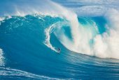 MAUI, HI - MARCH 13: Professional surfer Billy Kemper catches a giant wave at the legendary big wave