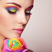 Portrait Of Beautiful Young Woman With Rainbow Rose. Bright Colors. Long Eyelashes, Vivid Colorful E poster