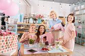 Decorated Event Agency. Four Appealing Friends Feeling Festive While Having Baby Shower In Decorated poster