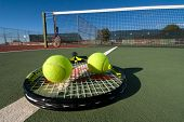 stock photo of deuce  - An image depicting the concept of tennis including the court racquets balls and blue outdoors - JPG