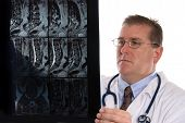 foto of medical exam  - Conceptual image of a doctor examining a patients MRI - JPG
