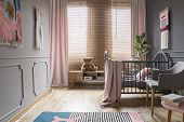 Drapes And Blinds On Windows In Childs Bedroom Interior With Pink Blanket On Bed. Real Photo poster