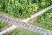 Aerial view of Katy Trail crossing highway near Pilot Grove, Missouri> it is a 237 mile bike trail s poster