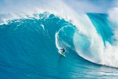 MAUI, HI - MARCH 13: Professional surfer Carlos Burle rides a giant wave at the legendary big wave s