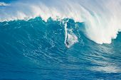 MAUI, HI - MARCH 13: Professional surfer Billy Kemper rides a giant wave at the legendary big wave s