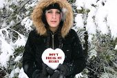 Sad Girl Holding Heart Of Snow