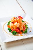 Battered king prawns on a bed of steamed broccoli and carrot top with sweet honey sauce and sasemi s