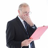 Appalled Businessman Reading Report