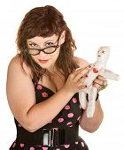 Woman With Glasses And Voodoo Doll