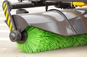 picture of sweeper  - A brand new street sweeper broom of a truck