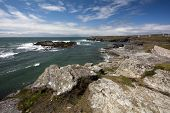 image of anglesey  - Rocky coastline and clouds in Trearrdur Bay Anglesey North Wales - JPG
