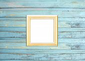 Gold Vintage Picture Frame On Blue Wood Background